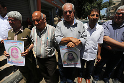 June 11, 2017 - Gaza City, Gaza Strip, Palestinian Territory - Palestinian men take part in a protest to show solidarity with Palestinian female prisoners held in Israeli jails, in Gaza city on June 08, 2017  (Credit Image: © Mohammed Asad/APA Images via ZUMA Wire)