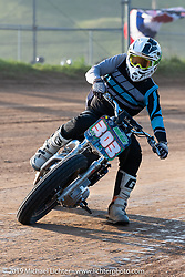 Hooligan flattracker (no. 303) Chad Tyson on his Harley-Davidson racer in the Spirit of Sturgis races at the fairgrounds during the Sturgis Black Hills Motorcycle Rally. Sturgis, SD, USA. Monday, August 5, 2019. Photography ©2019 Michael Lichter.