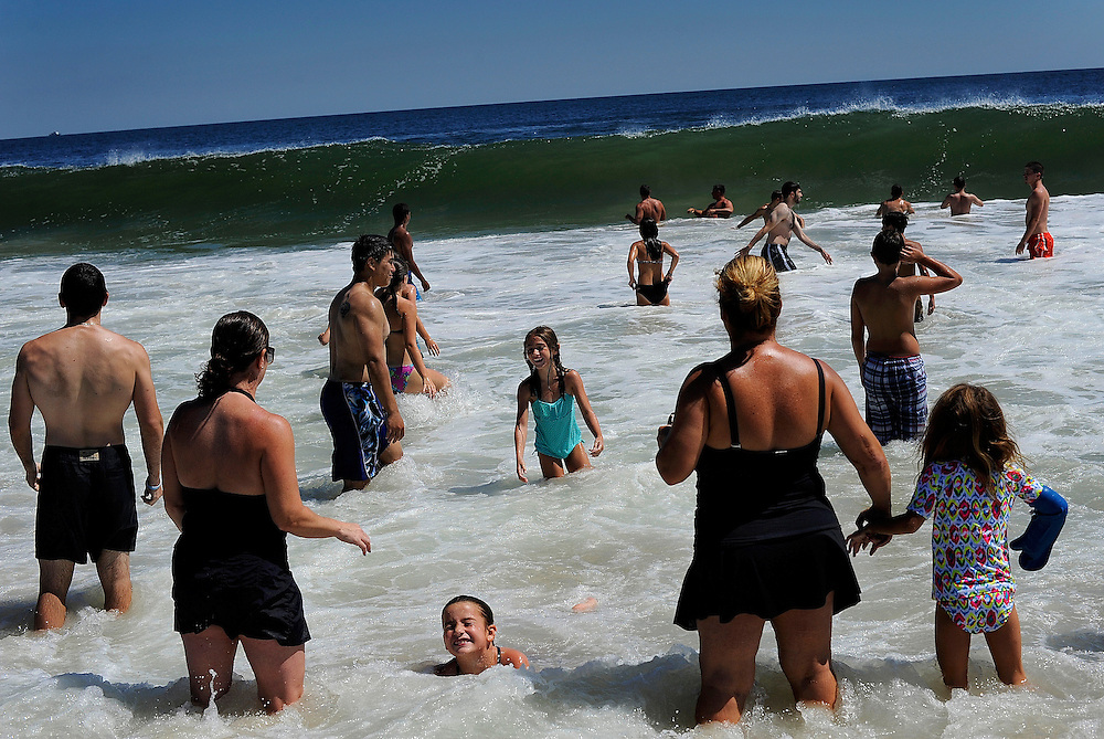 Beachgoers of all ages enjoy a swim in the strong waters along the beaches in Long Branch on August 28.