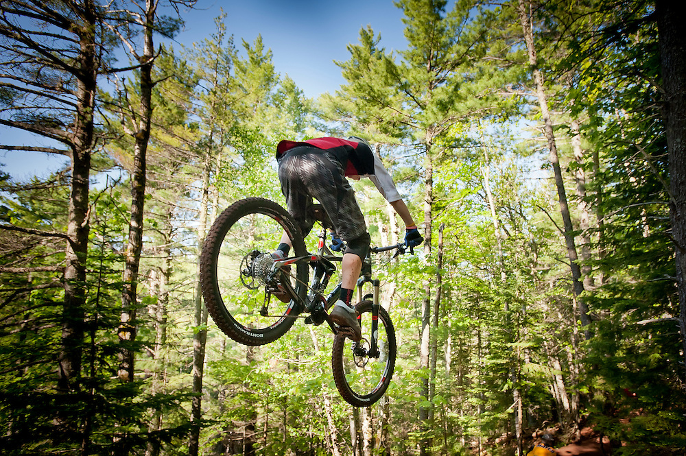 Mountain bikers ride the Flying Squirrel trail in Copper Harbor Michigan.