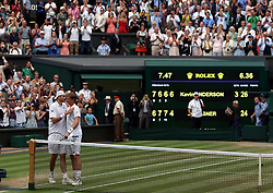 Kevin Anderson (right) and John Isner after his 7-6 (8/6) 6-7 (5/7) 6-7 (9/11) 6-4 26-24 win in the longest semi-final in the tournament's history on day eleven of the Wimbledon Championships at the All England Lawn Tennis and Croquet Club, Wimbledon.