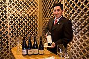 Wine steward at the Yan Kee Way Lodge, Ensenada, Chile..MODEL RELEASED