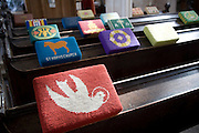 Embroidered prayer kneelers on pews in church of St Mary, Erwarton, Suffolk