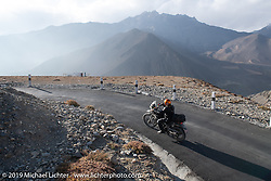Cool Beans Chris Marino riding a Royal Enfield Himalayan up the smoothest road we encountered up to Muktinath during Motorcycle Sherpa's Ride to the Heavens motorcycle adventure in the Himalayas of Nepal. On the fourth day of riding, we went from Kalopani to Muktinath. Thursday, November 7, 2019. Photography ©2019 Michael Lichter.