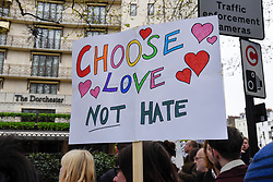 © Licensed to London News Pictures. 06/04/2019. LONDON, UK.  A sign held up by a member of the LGBT community during a protest outside the Brunei-owned Dorchester Hotel in reaction to reports that the Sultan of Brunei decreed that adultery and gay sex is punishable by death by stoning in the Islamic sultanate.  Several large clients of the Dorchester Hotel have already ceased bookings in response to the decree.  Photo credit: Stephen Chung/LNP