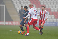 Swansea City midfielder Wayne Routledge(15) and Stevenage defender Scott Cuthbert(5) battles for possession during the FA Cup match between Stevenage and Swansea City at the Lamex Stadium, Stevenage, England on 9 January 2021.