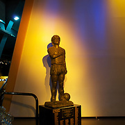 A statue of Argentina and Boca Juniors most famous footballer, Diego Maradona, in the entrance to the museum at Boca Juniors football stadium, La Bombonera, in La Boca region of Buenos Aires, Argentina, 25th June 2010. Photo Tim Clayton..