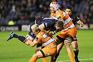 Tian Schoeman tackes James Johnstone during the Guinness Pro 14 2018_19 match between Edinburgh Rugby and Toyota Cheetahs at BT Murrayfield Stadium, Edinburgh, Scotland on 5 October 2018.
