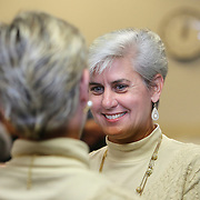 Osceola County Commissioner Cheryl Grieb (right) is seen as she listens to wedding vows from her partner Patti Daugherty during Osceola County Florida's first gay marriage which started just after midnight on January 6, 2015 at the Osceola County courthouse in Kissimmee, Florida.  (AP Photo/Alex Menendez)