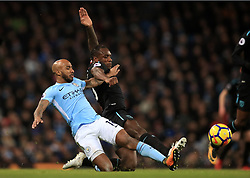 Manchester City's Fabian Delph (left) and West Ham United's Michail Antonio battle for the ball