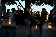 Family of Elijah Ortega, including father Manny Ortega, left, stand together at a candlelight vigil at Pesci Park Thursday, June 25, 2020 in Windsor Locks, Conn.  Elijah Ortega was murdered Wednesday evening in the park.  (Jessica Hill/Journal Inquirer)