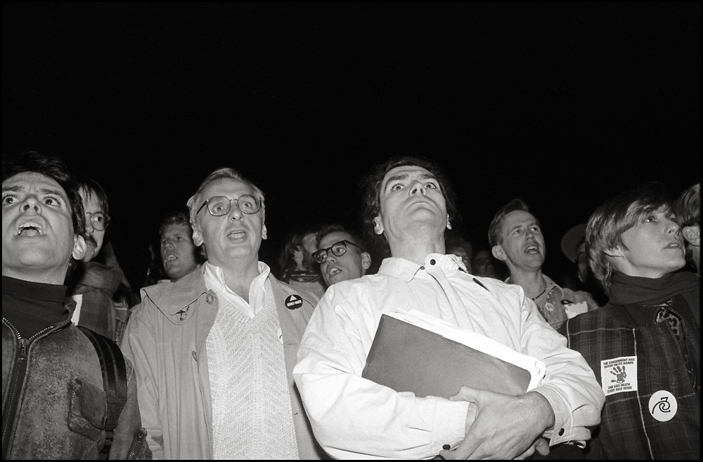 """ACT UP participates in a candlelight vigil the in DC the night before the """"SEIZE CONTROL OF THE FDA"""" action at the Food and Drug Administration Headquarters in Rockville, Maryland on October 11, 1988"""