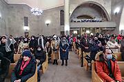 Believers attend a service on Christmas eve, in the Saint Gregory the Illuminator Cathedral, in Yerevan, Armenia on Tuesday, Jan 5, 2021. Armenia celebrates Christmas on January 6, adhering to the Armenian Apostolic Orthodox Church. (Photo/ Vudi Xhymshiti)
