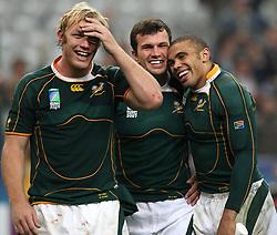 South Africa's Bismarck du Plessis (c), Bryan Habana (r) and Schalk Burger (l) celebrate after the final whistle.