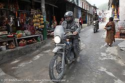 Kelly Modlin passing through Modibeni on Day-7 of our Himalayan Heroes adventure riding from Tatopani to Pokhara, Nepal. Monday, November 12, 2018. Photography ©2018 Michael Lichter.