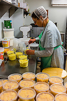 A Mennonite woman packaging macaroni salad and egg salad at Heritage Family Market, Fincastle, Botetourt County. near Roanoke, Virginia USA.