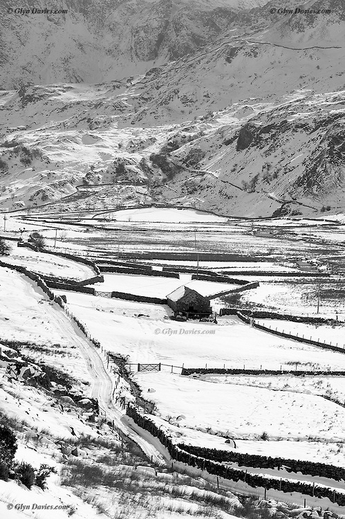 A snow covered Nant Ffrancon Pass, in Snowdonia, Wales. Cwm Idwal can be seen in the distance, at the base of Glyder Fawr. The famous Devil's Kitchen cleft can just be seen in the centre top of the image.