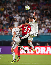 July 31, 2018 - Miami Gardens, Florida, USA - Real Madrid C.F. defender Nacho Fernandez (6) (right) leaps to head the ball above Manchester United F.C. defender James Garner (37) (center) Real Madrid C.F. midfielder Oscar Rodriguez (35) (left) during an International Champions Cup match between Real Madrid C.F. and Manchester United F.C. at the Hard Rock Stadium in Miami Gardens, Florida. Manchester United F.C. won the game 2-1. (Credit Image: © Mario Houben via ZUMA Wire)