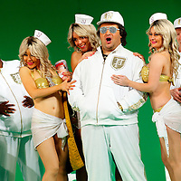 Picture shows : Tiziano Bracci as Mustafa with bunny girls..Picture  ©  Drew Farrell Tel : 07721 -735041..A new Scottish Opera production of  Rossini's 'The Italian Girl in Algiers' opens at The Theatre Royal Glasgow on Wednesday 21st October 2009..(Soap) opera as you've never seen it before.Tonight on Algiers.....Colin McColl's cheeky take on Rossini's comic opera is a riot of bunny girls, beach balls, and small screen heroes with big screen egos. Set in a TV studio during the filming of popular Latino soap, Algiers, the show pits Rossini's typically playful and lyrical music against the shoreline shenanigans of cast and crew. You'd think the scandal would be confined to the outrageous storylines, but there's as much action off set as there is on.....Italian bass Tiziano Bracci makes his UK debut in the role of Mustafa. Scottish mezzo-soprano Karen Cargill, who the Guardian called a 'bright star' for her performance as Rosina in Scottish Opera's 2007 production of The Barber of Seville, sings Isabella..Cast .Mustafa...Tiziano Bracci.Isabella..Karen Cargill.Lindoro...Thomas Walker.Elvira...Mary O'Sullivan.Zulma...Julia Riley.Haly...Paul Carey Jones.Taddeo...Adrian Powter..Conductors.Wyn Davies.Derek Clarke (Nov 14)..Director by Colin McColl.Set and Lighting Designer by Tony Rabbit.Costume Designer by Nic Smillie..New co-production with New Zealand Opera.Production supported by.The Scottish Opera Syndicate.Sung in Italian with English supertitles..Performances.Theatre Royal, Glasgow - October 21, 25,29,31..Eden Court, Inverness - November 7. .His Majesty's Theatre, Aberdeen  - November 14..Festival Theatre,Edinburgh - November 21, 25, 27 ...Note to Editors:  This image is free to be used editorially in the promotion of Scottish Opera. Without prejudice ALL other licences without prior consent will be deemed a breach of copyright under the 1988. Copyright Design and Patents Act  and will be subject to payment or legal action, where appropriate..Further further inf