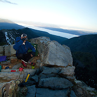Brewing some moning coffee atop Lincoln Peak in Glacier National Park.