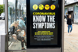 Edinburgh, Scotland, UK. 4 June 2020.  As Covid-19 lockdown relaxation continues in Scotland very few shops and businesses are open. Streets remain quiet and pubs and, with a few exceptions, bars and pubs are closed. Pictured; Coronavirus warning messages at bus stops on Princes Street. Iain Masterton/Alamy Live News