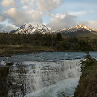 Morning clouds billow over Paine Falls, the Towers of Paine & Monte Almirante Nieto (L) in Torres del Paine National Park in Patagonia, Chile.