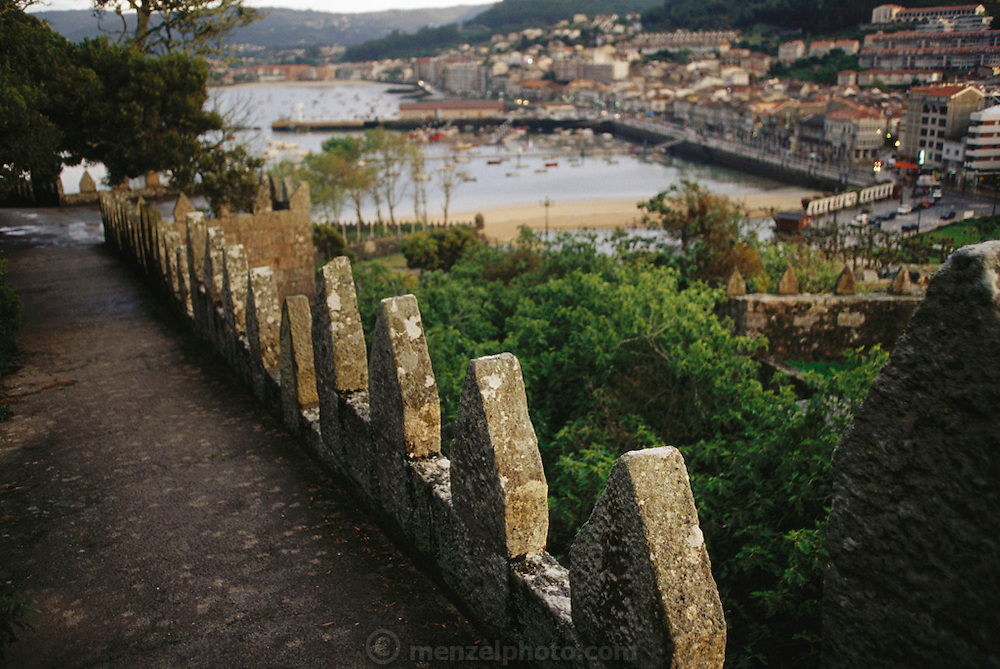 The walls and town of Bayona, from the Parador de Bayona, a converted fortress island.  Galicia, North West Spain.