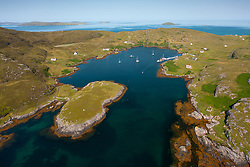 Aerial view from drone of harbour at Acairseid Mhor on island of Eriskay in the Outer Hebrides, Scotland, UK