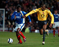 Photo: Ed Godden.<br />Portsmouth v Arsenal. The Barclays Premiership. 12/04/2006. Benjani Mwaruwari (L) and Arsenals Abou Diaby.