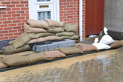 Sandbags propped up outside a front door after torrential rain caused flooding in Oxford and the Thames Valley area; July 2007,