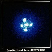 Einstein Cross Quasar: Gravitation Lens G2237+0305. NASA photograph.