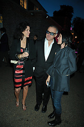 Left to right, MOLLIE DENT-BROCKLEHURST, DAMIEN HIRST and SUE WEBSTER at the annual Serpentine Gallery Summer Party sponsored by Canvas TV  the new global arts TV network, held at the Serpentine Gallery, Kensington Gardens, London on 9th July 2009.