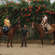 Alexandra Perez, American-Puerto Rican with Doc (12 years old horse), Nolberto Mendez from Honduras  and Caitltyn Reiners from Bay Shore with Jonah (8 year old horse) pose for a photograph at Knoll Farm located in Brentwood.