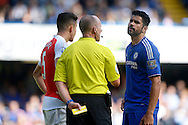 Referee Michael Dean has words with Diego Costa of Chelsea before dealing with Gabriel of Arsenal after their scuffle. Barclays Premier League match, Chelsea v Arsenal at Stamford Bridge in London on Saturday 19th September 2015.<br /> pic by John Patrick Fletcher, Andrew Orchard sports photography.