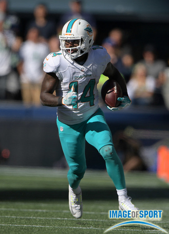 Sep 11, 2016; Seattle, WA, USA; Miami Dolphins wide receiver Jarvis Landry (14) carries the ball on a 28-yard reception against the Seattle Seahawks during a NFL game at CenturyLink Field. The Seahawks defeated the Dolphins 12-10.