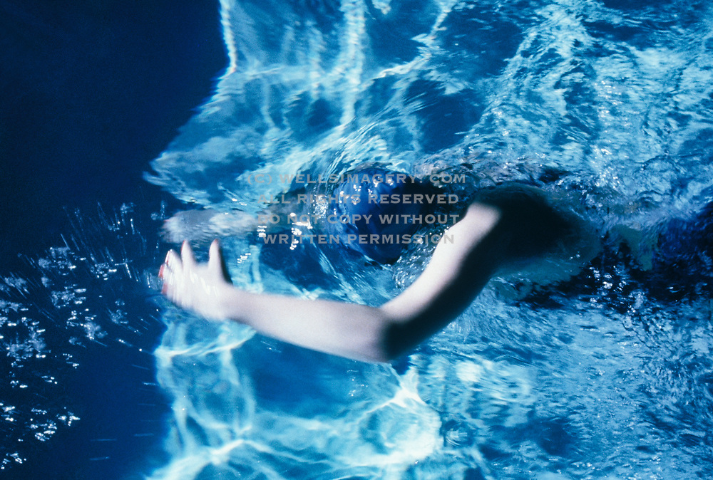 Image of a female swimmer underwater, model released by Randy Wells