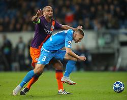 Manchester City's Vincent Kompany (left) and Hoffenheim's Pavel Kaderabek battle for the ball