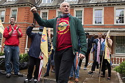 London, UK. 30th July, 2021. Chip Hamer of Poetry on the Picket Line recites a poem to Royal Parks workers outsourced via French multinational VINCI Facilities attending a picket outside the Old Police House in Hyde Park as part of joint strike action by the United Voices of the World (UVW) and Public and Commercial Services (PCS) trade unions. The joint strike, with members dual carding over pay, conditions and the sacking of a member of staff, is believed to be the first between a TUC and a non-TUC trade union and follows the launch of a legal challenge by the Royal Parks workers against indirect racial discrimination by the Royal Parks.
