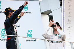 Third placed Nico Rosberg (GER) Mercedes AMG F1 celebrates on the podium by drinking champagne from the race boot of race winner Daniel Ricciardo (AUS) Red Bull Racing.<br /> 02.10.2016. Formula 1 World Championship, Rd 16, Malaysian Grand Prix, Sepang, Malaysia, Sunday.<br />  Copyright: Bearne / XPB Images / action press