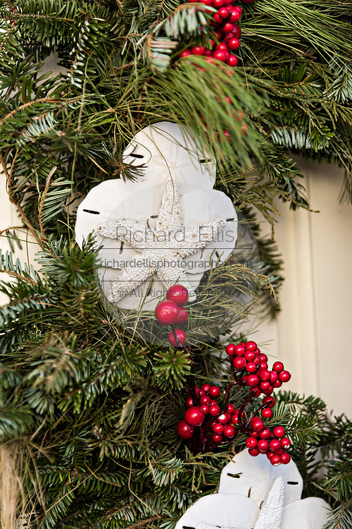 Starfish and sand dollars decorate a Christmas wreath at a historic home on Tradd Street in Charleston, SC.