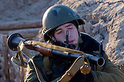 Kamenka, Karelia, Russia, 14/12/2007..A professional Russian soldier in the trenches with a rocket launcher during Snezhinka [Snowflake] 2007, a joint live fire training exercise for Russian and Swedish motorised infantry in which they play the roles of a combined peace-keeping force enforcing a demilitarised zone in a warring region.