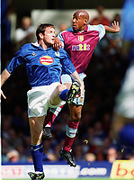 Dion Dublin (Aston Villa) Gerry Taggart (Leicester City). Leicester City v Aston Villa, 19/8/2000, F.A. Carling Premiership. Credit : Colorsport / Matthew Impey.