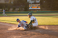San Marin catcher Mitchell Ho tags Acalanes High's Zac Schoenrock in the top of the 10th inning of the North Coast Section Division 3 championship game. The  umpires suspended the game after 10 complete innings with the score 4-4. NCS officials later declared both teams Co-champions.
