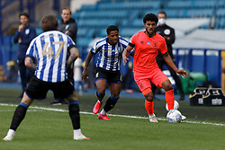 Kadeem Harris of Sheffield Wednesday and Elias Kachunga of Huddersfield Town - Mandatory by-line: Daniel Chesterton/JMP - 24/06/2020 - FOOTBALL - Hillsborough - Sheffield, England - Sheffield Wednesday v Huddersfield Town - Sky Bet Championship