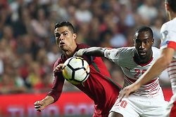 October 10, 2017 - Lisbon, Portugal - Portugal's forward Cristiano Ronaldo (L) fights for the ball with Switzerland's defender Johan Djourou during the 2018 FIFA World Cup qualifying football match between Portugal and Switzerland at the Luz stadium in Lisbon, Portugal on October 10, 2017. Photo: Pedro Fiuza  (Credit Image: © Pedro Fiuza/NurPhoto via ZUMA Press)