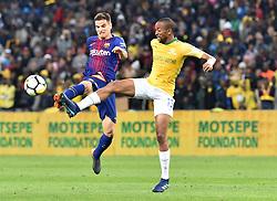 Mamelodi Sundowns player Tiyane Mabunda and Barcelona FC player Ruiz de Galarreta <br />battle for the ball during Mandela Centenary Cup at FNB stadium, Gauteng.<br />Picture: Itumeleng English/African News Agency (ANA)