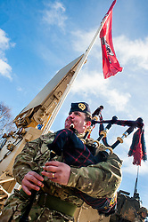 A piper from 19 Regiment Royal Artillery (The Scottish Gunners) provides a little entertainment for the Military, Media and civilian contractors visiting exercise Steel Sabre. A large Scale military live fire exercise on Otterburn Training Area it involves 1400 troops the majority from the Royal Artillery 1st Artillery Brigade and brings all the components of an effective Artillery group together to train in delivering firepower on the battlefield.<br /> <br />   02 March 2017 <br />   Copyright Paul David Drabble<br />   www.pauldaviddrabble.co.uk