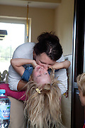 Polish mom playing with her daughter age 32 and 4 in their home. Zawady Central Poland