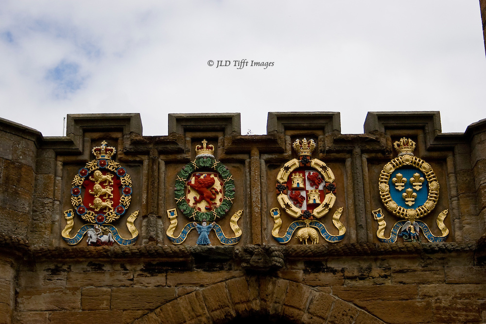 Orders of chivalry emblems above the entrance gate to Linlithgow Castle: from left to right: orders of the garter, thistle, golden fleece, and St. Michael..  Gate built 1533 by King James V.