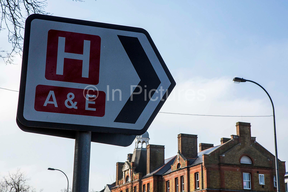 Road traffic sign directing people to an accident and emergency department in University Hospital Lewisham, London, UK.